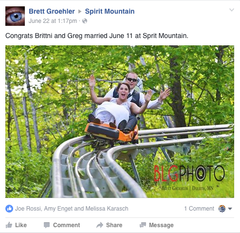A newly wed couple in tux and gown riding the Alpine Coaster