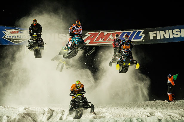 Snowmobiles racing through the snow